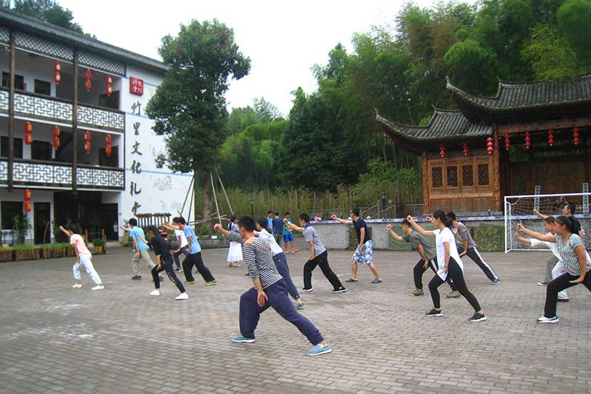 Students practice martial arts outdoors at Wenli School in Wenzhou, Zhejiang province, Sept. 9, 2016. Cai Yiwen/Sixth Tone