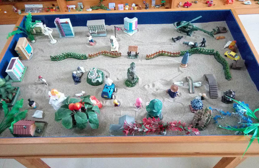 A sand table with toys, used for psychotherapy at Yancheng Prison, Hebei province, Sept. 22, 2016. Li Lubao for Sixth Tone
