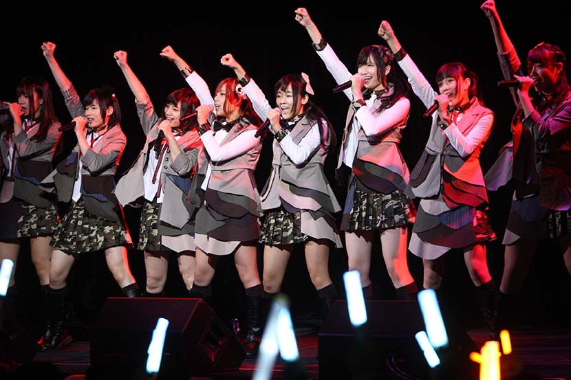Members of SNH48 perform during the 'Give Me More' concert in Shanghai, Jan. 12, 2013. VCG