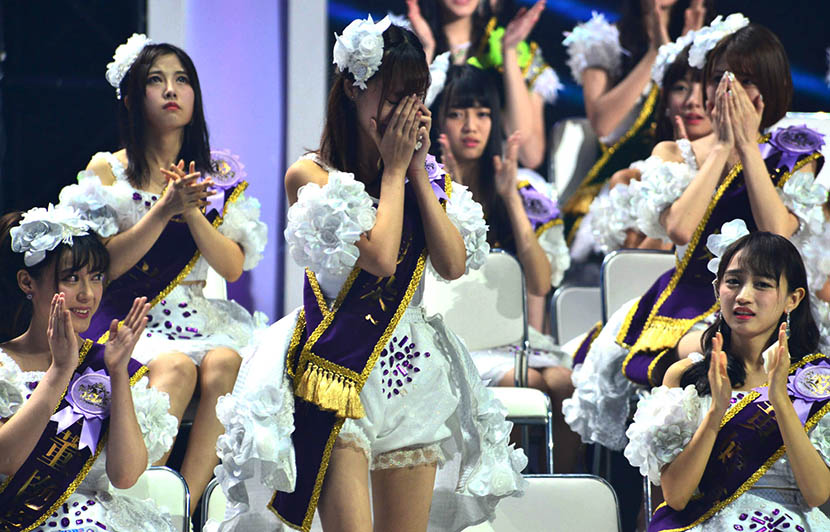 Members of SNH48 react during the final of the second SNH48 Idols Annual Popularity Contest, July 25, 2015. Shen Chunchen/IC