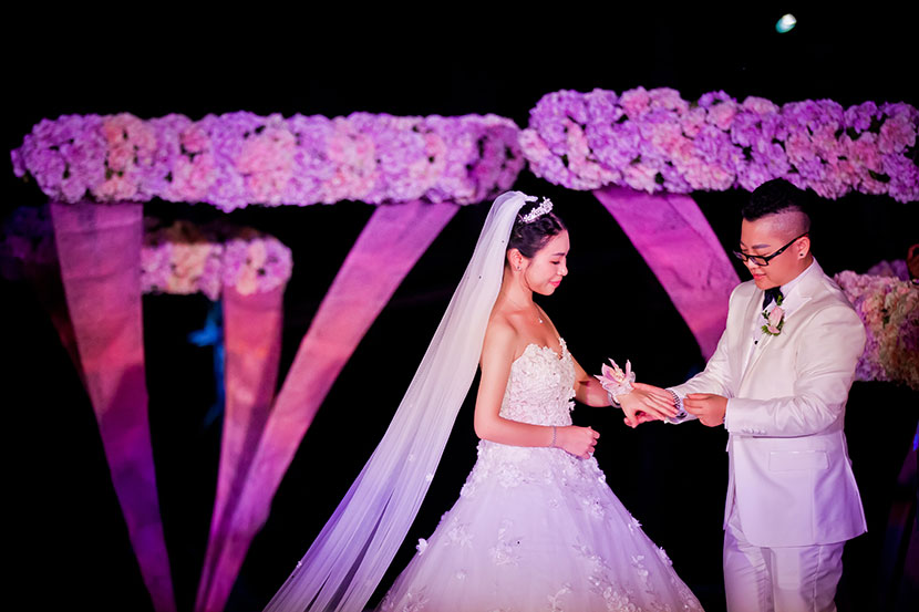 Aries Liu puts a ring on Yao Mei's finger during their wedding in Sanya, Hainan province, Sept. 14, 2016. Courtesy of Aries Liu