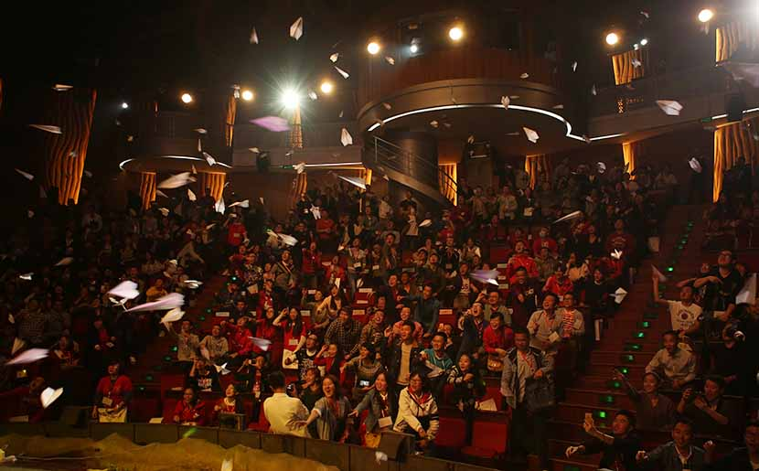The audience throws paper planes into the air during Speak Out, a public forum on LGBT issues, at Jinsha Theater in Chengdu, Sichuan province, Oct. 15, 2016. Courtesy of Milks Friends