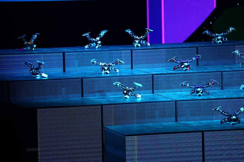 Robots designed at the Harbin Institute of Technology 'perform' during CCTV's annual Spring Festival Gala in Beijing, Jan. 22, 2012. VCG