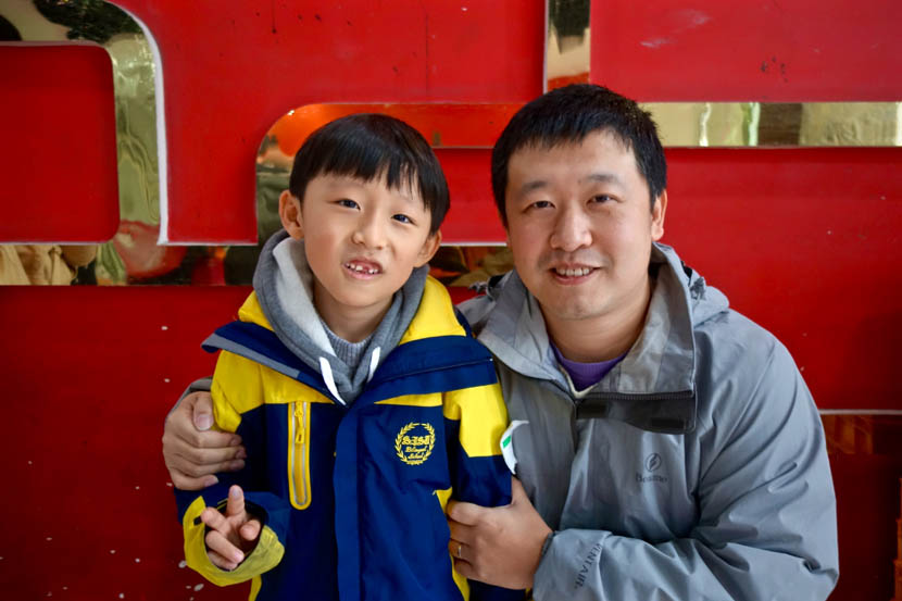 Rocky Liu poses for a photo with his son Teal'c in Shanghai, Nov. 26, 2016. Juli Min for Sixth Tone