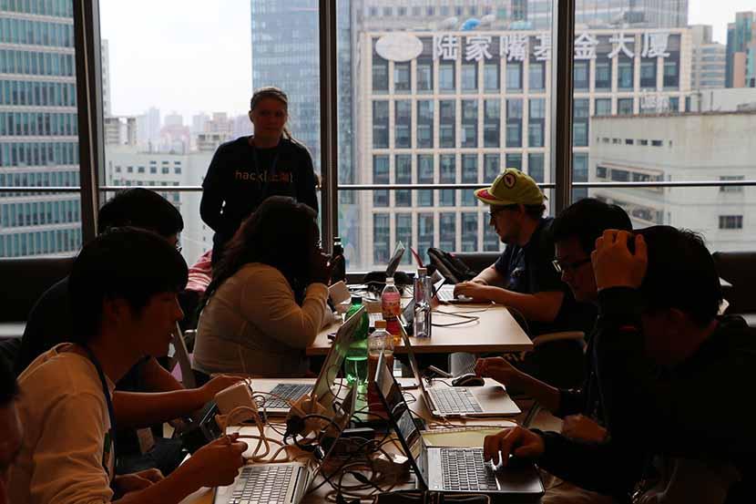 Students attend a 'Hack Shanghai' event on campus at New York University Shanghai, Nov. 15, 2014. Zhou Kai/VCG