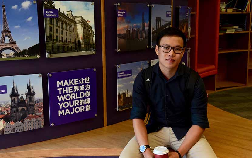 Michael Lukiman sits in the student lounge he helped design on New York University's Shanghai campus, September 2016. Li Sizhe for Sixth Tone
