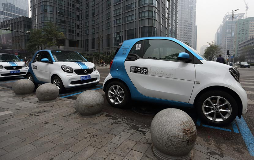 Rentable TOGO Smart cars are seen parked on the side of the road in Beijing, Oct. 15, 2016. Song Fan/IC