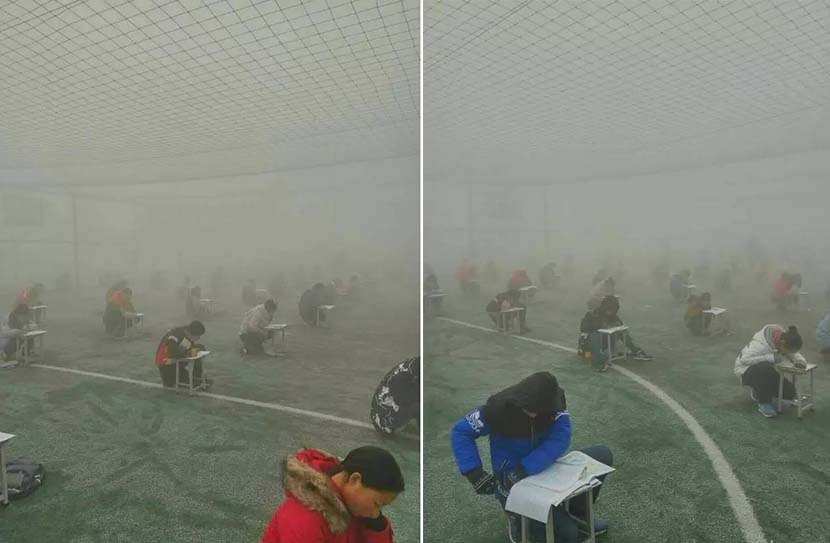 Photos show students taking tests on an outdoor field during heavy pollution, Linzhou, Henan province, Dec. 21, 2016. @dahebao from Weibo