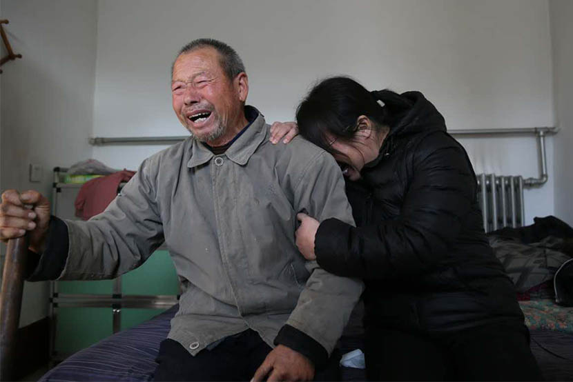 Nie Shubin's father and elder sister cry after hearing that the Supreme People's Court ruled Nie innocent, Niezhuang Village, Shijiazhuang, Hebei province, Dec. 2, 2016. Xie Kuangshi/Sixth Tone