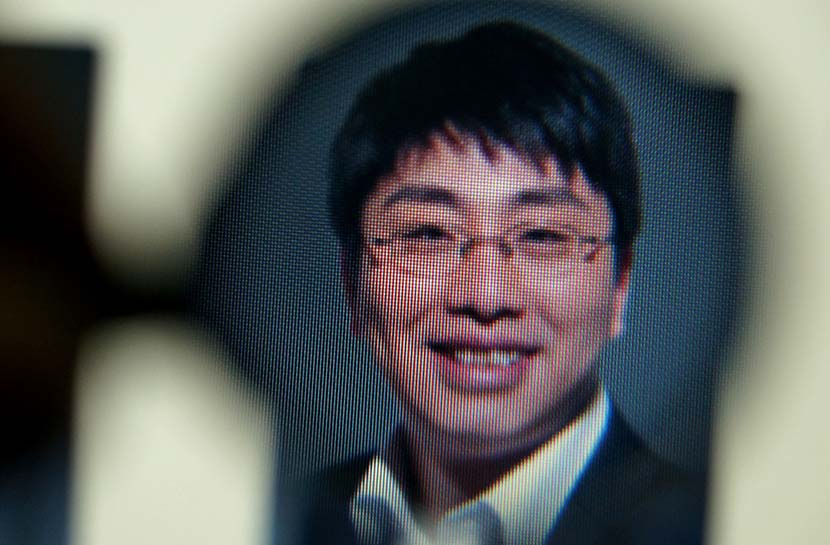 A screenshot shows an image of Wang Can, co-founder of Jingjinlian, who was detained by Wuhan police. IC