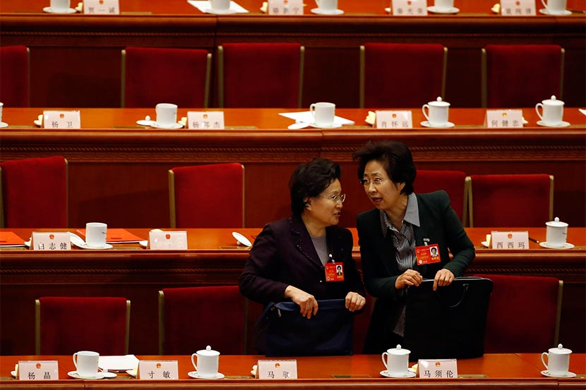 Female delegates talk during the closing ceremony of the Chinese National People's Congress at the Great Hall of the People in Beijing, March 13, 2014. Kim Kyung-Hoon/Reuters/VCG