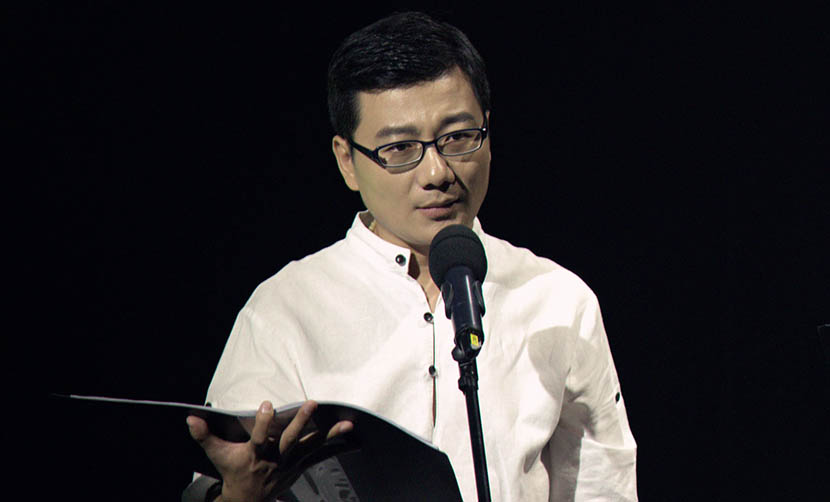 Jiang Guangtao on stage during a public event. Courtesy of VOICEGEM
