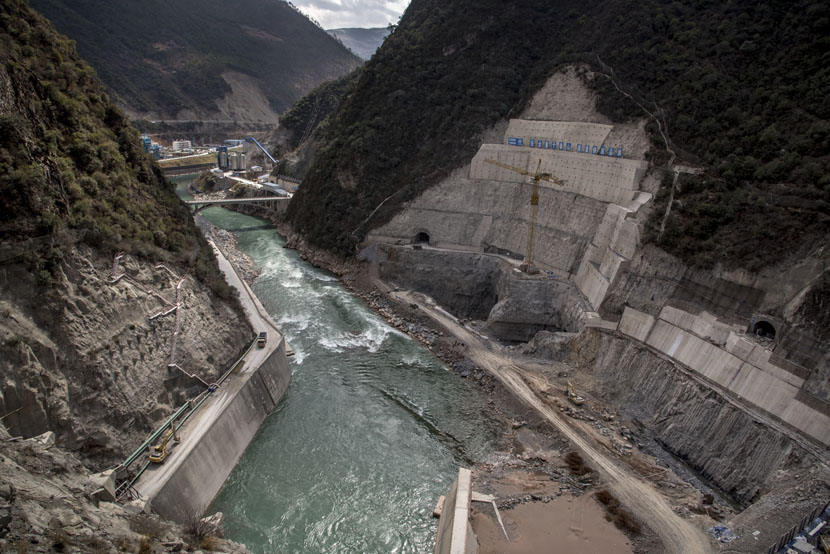 A hydropower dam owned by state-owned Sinohydro company is one of many construction projects underway along the Mekong River, Jinglin, Yunnan province, Feb. 15, 2016. Luc Forsyth for Sixth Tone