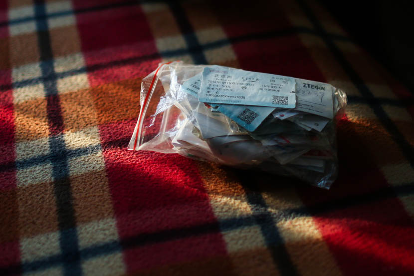 Train tickets from Li Eryou's trips between Beijing and Handan are collected in a bag in Handan, Hebei province, Dec. 23, 2014. Quan Yi/Sixth Tone