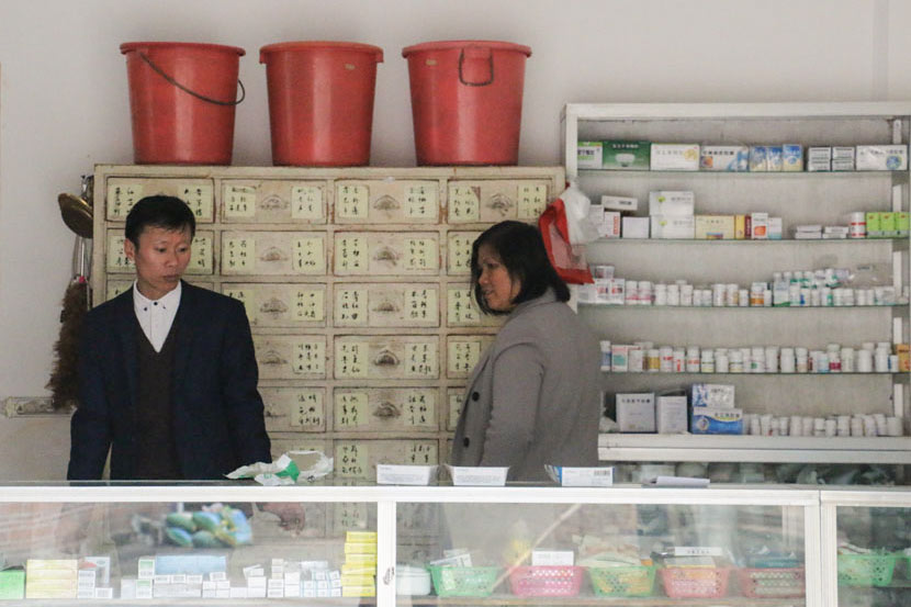 Zhang Hong and his wife stand in their clinic in Zhengdongbao Village, Guangxi Zhuang Autonomous Region, March 9, 2017. Cai Yiwen/Sixth Tone