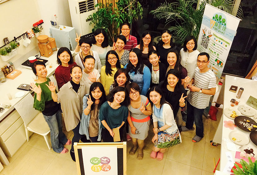 Participants pose for a photo at an event held by Veg Planet in Shanghai, May 15, 2015. Courtesy of Zhang Si