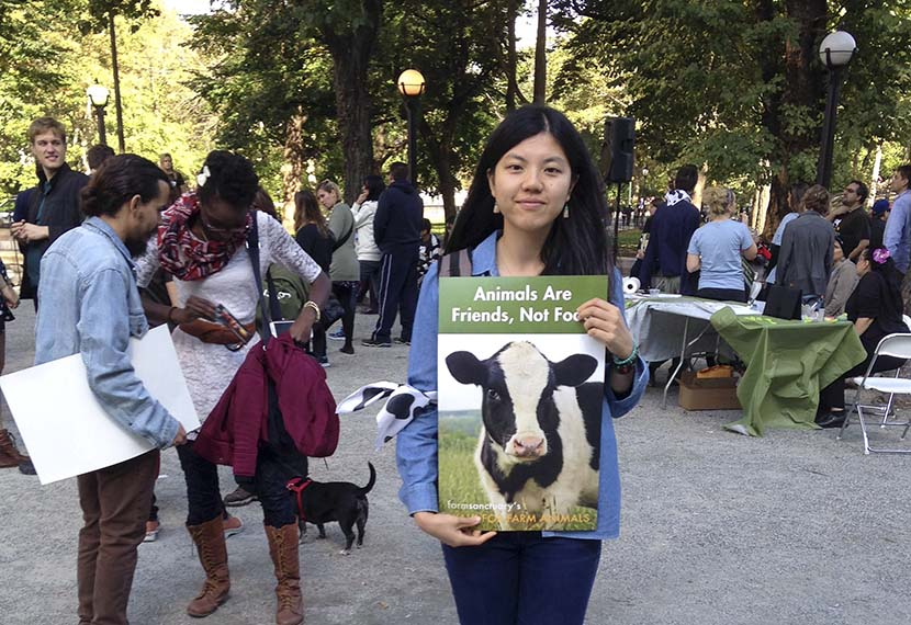 Zhang Si poses for a photo while volunteering at the annual Walk for Farm Animals in New York, Oct. 18, 2014. Courtesy of Zhang Si