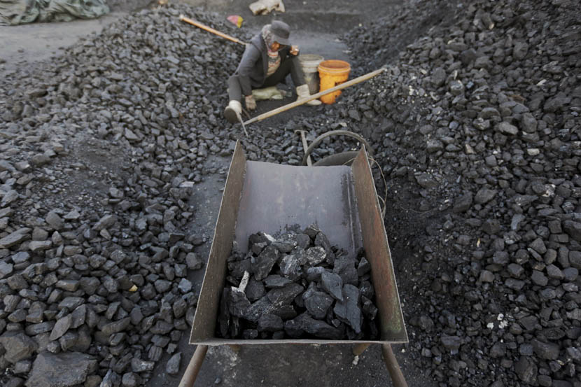 A worker sorts coal at the depot of a private mine on the outskirts of Jixi, Heilongjiang province, Oct. 23, 2015. Jason Lee/Reuters/VCG