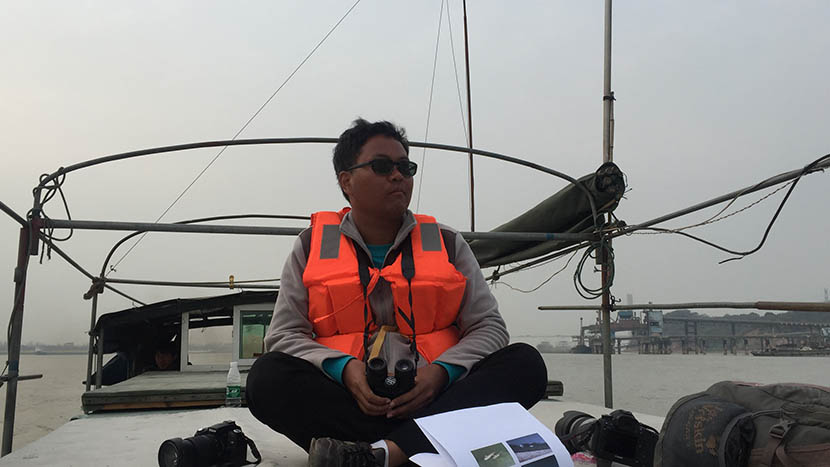 Volunteer, Ji Yingying, on the lookout for baiji dolphins in the Yangtze River, March 21, 2016. Shi Yi/Sixth Tone