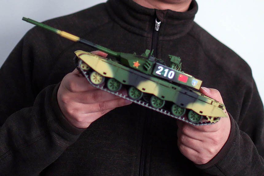 Iron Blood founder Jiang Lei holds a model tank at his office in Beijing, Jan. 19, 2016. Quan Yi/Sixth Tone