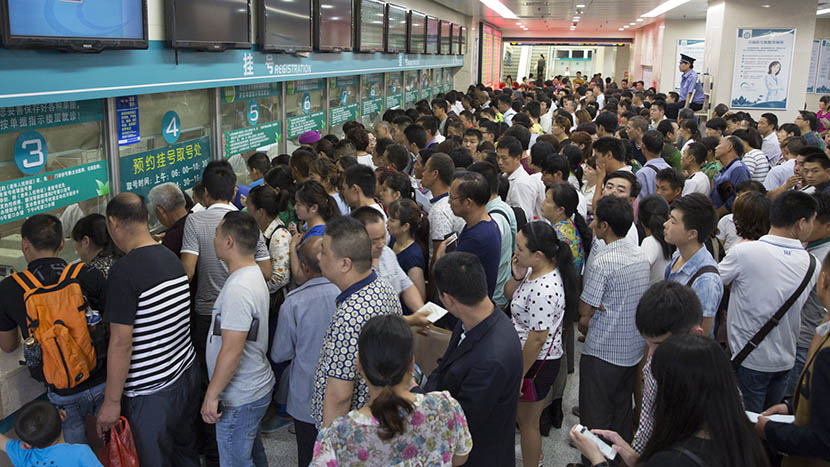 People crowd the outpatient service registration center at Zhengzhou First, China's largest hospital, in Zhengzhou, Henan province, June 28, 2015. Xu Xiaolin/Sixth Tone