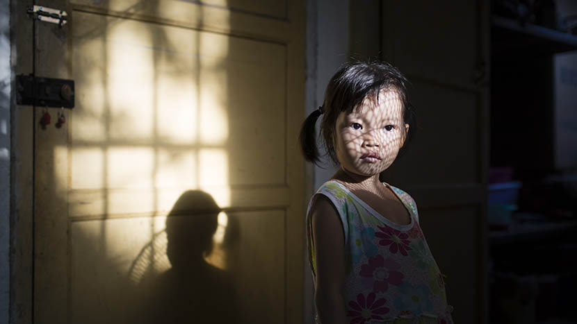 Dongmei stands in a room her mother has rented for Dongmei's treatment in a suburban village nearby Nanning, Guangxi Zhuang Autonomous Region, Sept. 19, 2015. Zhou Pinglang/Sixth Tone