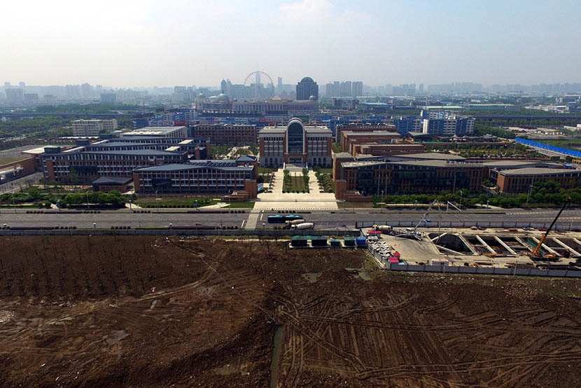 An aerial photo shows the new campus of Changzhou Foreign Languages School is next to the former site of Changlong's factory in Changzhou, Jiangsu province, April 18, 2016. IC