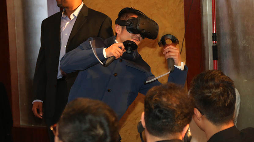 Boxer Zou Shuming experiencing virtual reality technology during a press conference at the 6th Beijing International Film Festival, April 19, 2016. Courtesy of The Filman Investing Management Co. Ltd., or 'Filman Group.'