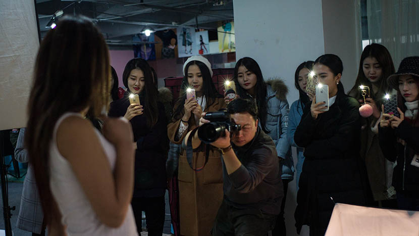 Taobao models are taught how to pose in front of a camera at a training center in Wuhan, Hubei province, Dec. 9, 2015. Ma Luyao/IC