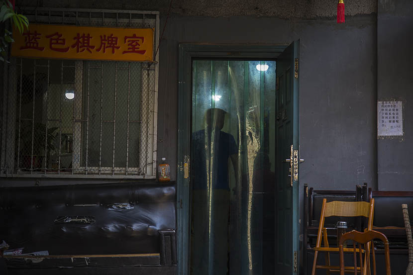A man stands in the doorway of a mahjong parlor popular among older gay people, Changsha, Hunan province, May 16, 2016. Wu Yue/Sixth Tone