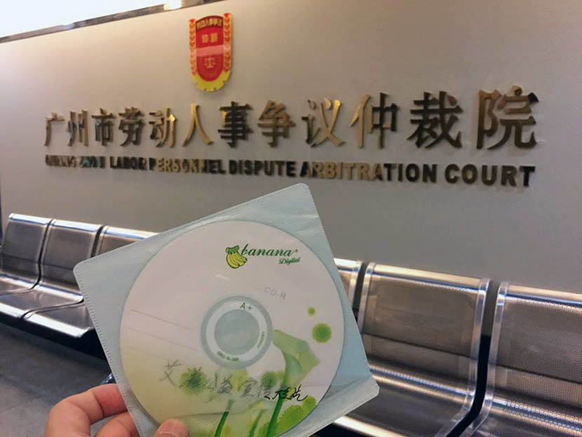 Lawyer Qiu Hengyu holds a disc containing an AIDS public service video at the Guangzhou Labor Dispute Arbitration Court, Guangdong province, June 12, 2016. Qiu Hengyu for Sixth Tone