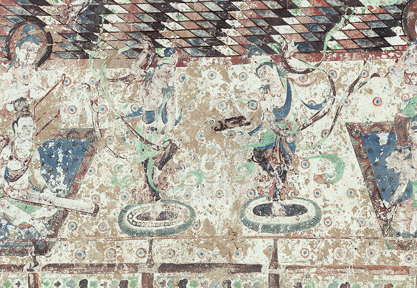 A mural in Cave 220 depicts dancing bodhisattvas, Dunhuang, Gansu province. Courtesy of the Dunhuang Academy