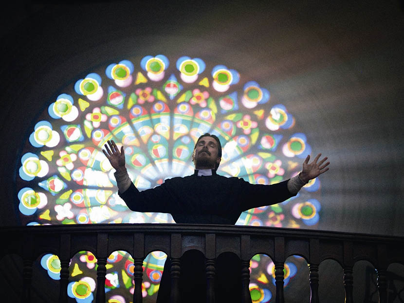 A still frame shows Christian Bale posing as a priest in 'The Flowers of War.' VCG