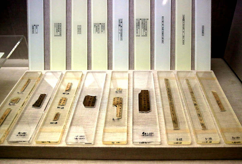 Bamboo slips are displaced in the Qin Bamboo Slips Museum in Liye Town, Hunan province, June 18, 2016. Peng Biao/IC