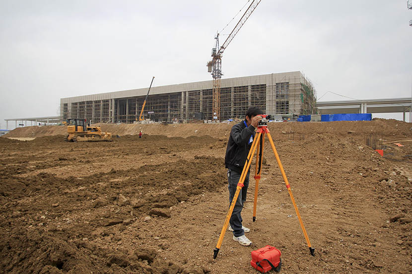 A worker surveys the land in front of the construction site of the Dingyuan high-speed rail station, Anhui province, May 27, 2011. Zhang Dong/Sixth Tone