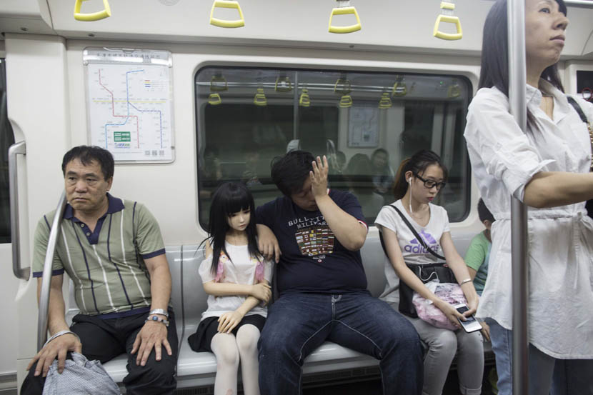 Song Bo takes subway with his doll 'Butterfly' in Tianjin, June 4, 2016. Xu Haifeng/Sixth Tone