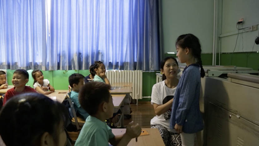 A teacher pretends to make sexual advances on a student during a role-playing activity at a Girls' Protection workshop in Beijing, June 2016. Han Meng/Sixth Tone