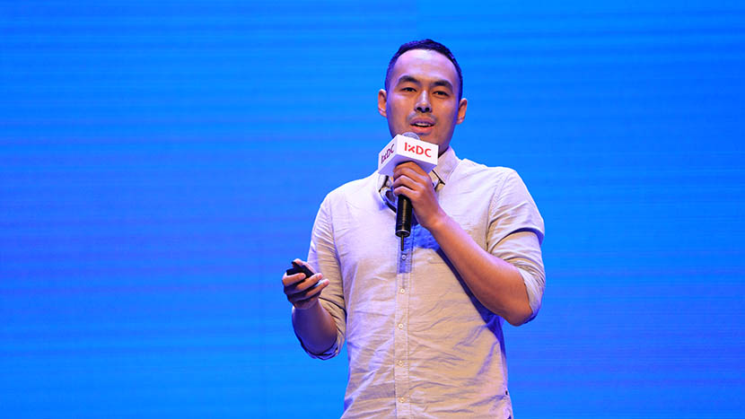 Liu Chao, former director of user experience at Baidu, gives a speech on the topic of 'redefining user experience' during the International Conference of Experience Design in Beijing, July 2, 2016. Quan Yajun/VCG