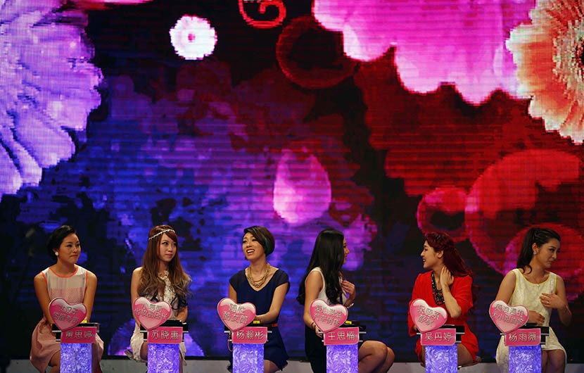 A panel of women answer questions during an episode of the matchmaking television program 'One Out of 100,' Shanghai, July 27, 2013. Carlos Barria/Reuters