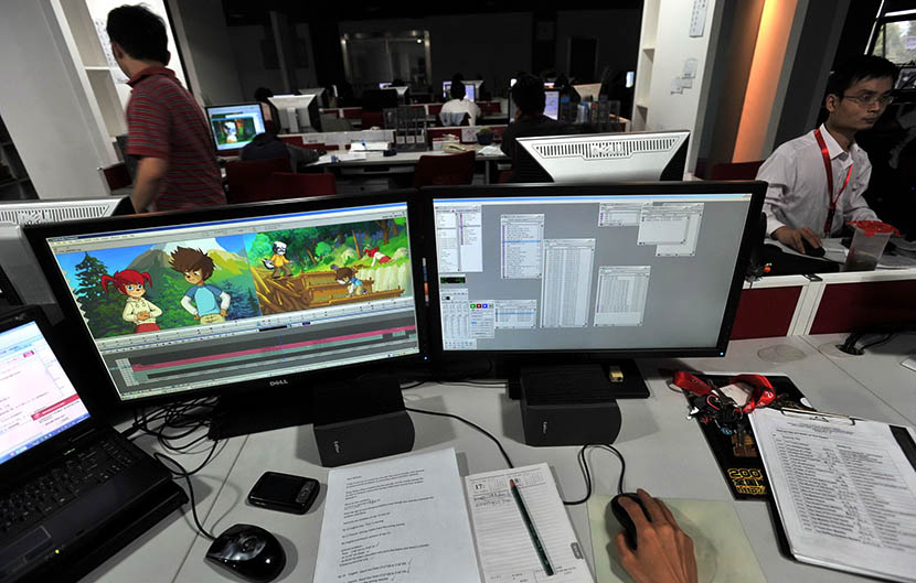 An animator works on a cartoon project in Wuhan, Hubei province, Oct. 10, 2009. The company made 13 million euros in 2008, but nearly 70 percent came from outsourcing jobs. Zhou Chao/EPA/IC