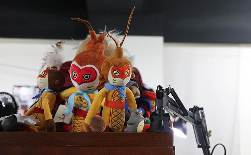 Dolls for the film 'Monkey King: Hero Is Back' sit on a desktop at the Thundray animation studio, Shanghai, July 27, 2016. Yin Yijun/Sixth Tone