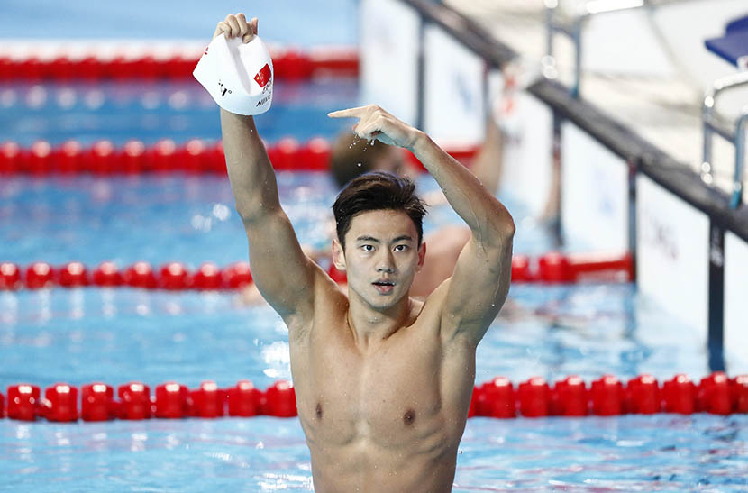 Ning Zetao of China celebrates after the gold medal in the men's 100-meter freestyle final during the FINA World Swimming Championships in Kazan, Russia, Aug. 6, 2015. Valdrin Xhemaj/EPA/IC