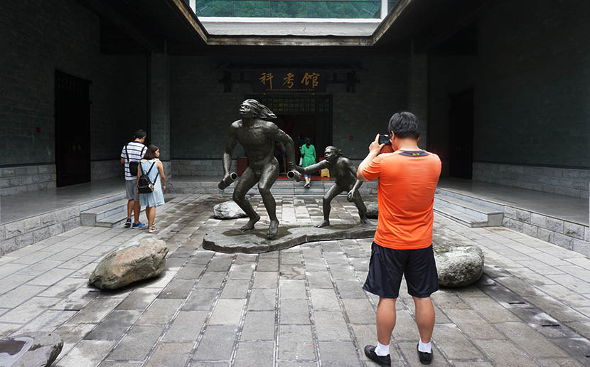 A Bigfoot statue stands in front of the natural history museum in Shennongjia, Hubei province, Aug. 3, 2016. Feng Jiayun/Sixth Tone