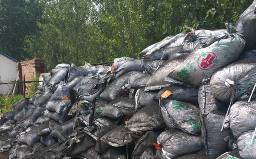 Bags of waste mercuric chloride catalyst are seen on the grounds of an agricultural company in Luoning County, Henan province, June 2016. Courtesy of an anonymous official from local department of the environment.