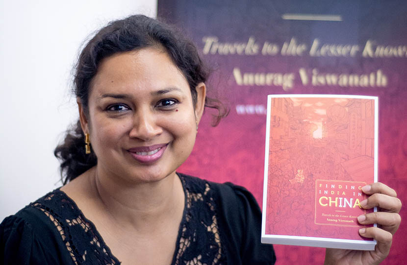 Anurag Viswanath holding her book 'Finding India in China' at a promotional event, Dec. 9, 2015. Courtesy of Anurag Viswanath