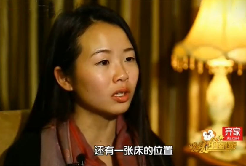 "A screenshot shows the Jiang family's 22-year-old daughter on an episode of the home improvement TV program ""A Warm New Home,"" broadcast in January 2016 on Beijing TV."