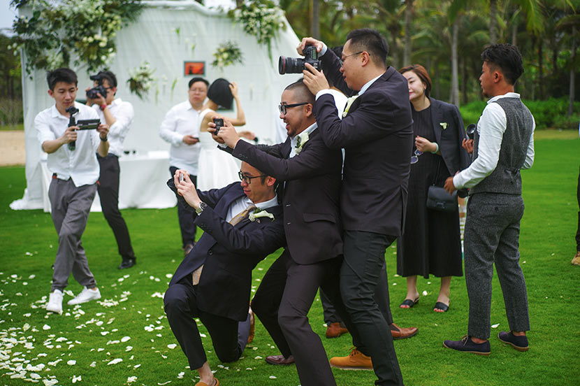 Guo Kun (front right) photographs a wedding ceremony in Shanghai, April 12, 2017. Courtesy of Guo Kun