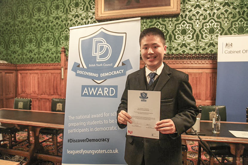 Zhang Zishi holds his certificate for the 'Discovering Democracy Award' at the British Youth Council in London, 2016. Courtesy of Zhang Zishi