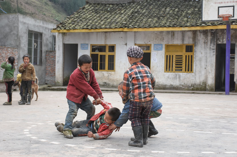 Students from the Yi ethnic group play with each other at a local primary school in Mabian Yi Autonomous County, Sichuan province, March 28, 2017. Courtesy of Xu Yang/Southwestern University of Finance and Economics