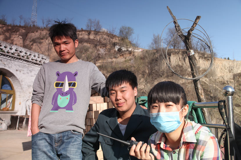 Zhu Hang (left) poses for a photo with members of the film crew in Lüliang, Shanxi province, April 3, 2013. Courtesy of Zhu Hang